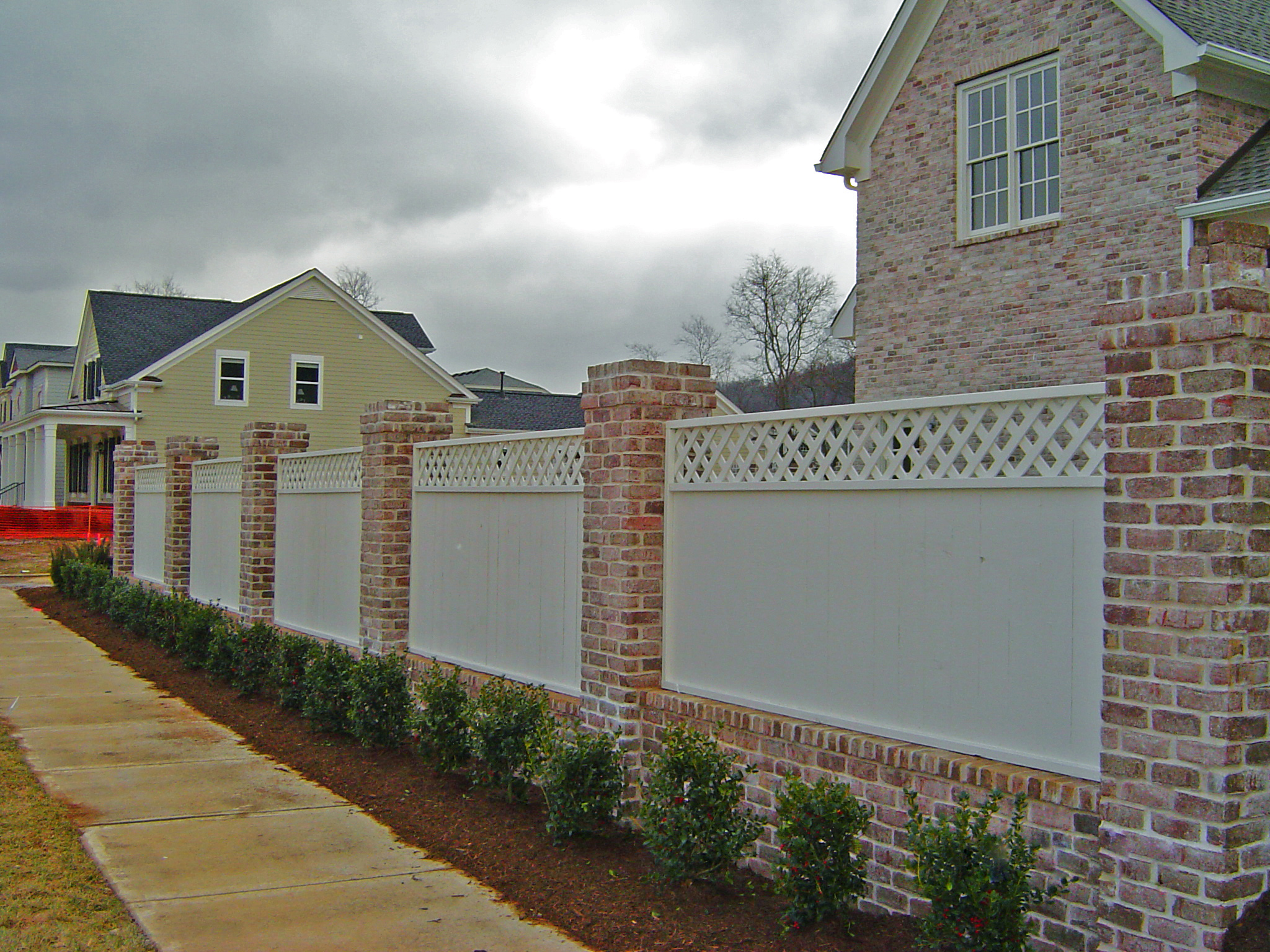 Brick Columns & Wood Privacy Fence